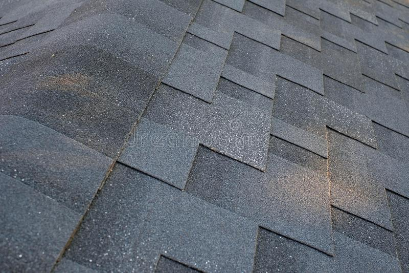Close up top view on corner roof made is asphalt roofing shingles. royalty free stock images