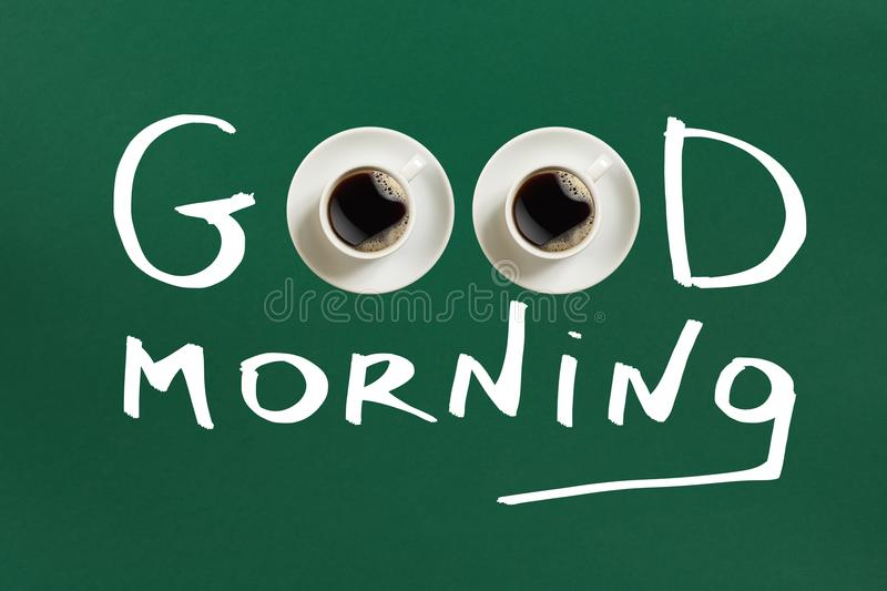 Close-up top view of cup of fresh hot coffee and good morning inscription royalty free stock photo