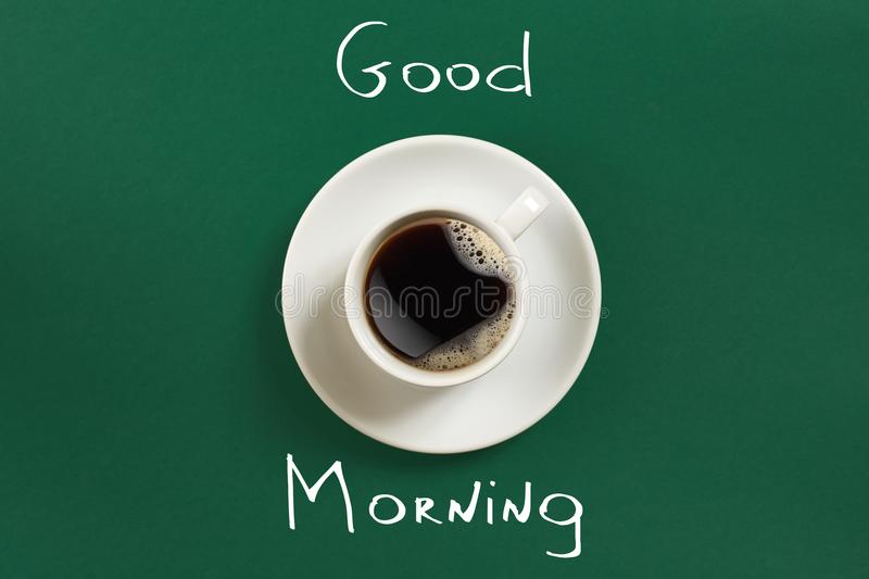 Close-up top view of cup of fresh hot coffee and good morning inscription royalty free stock image