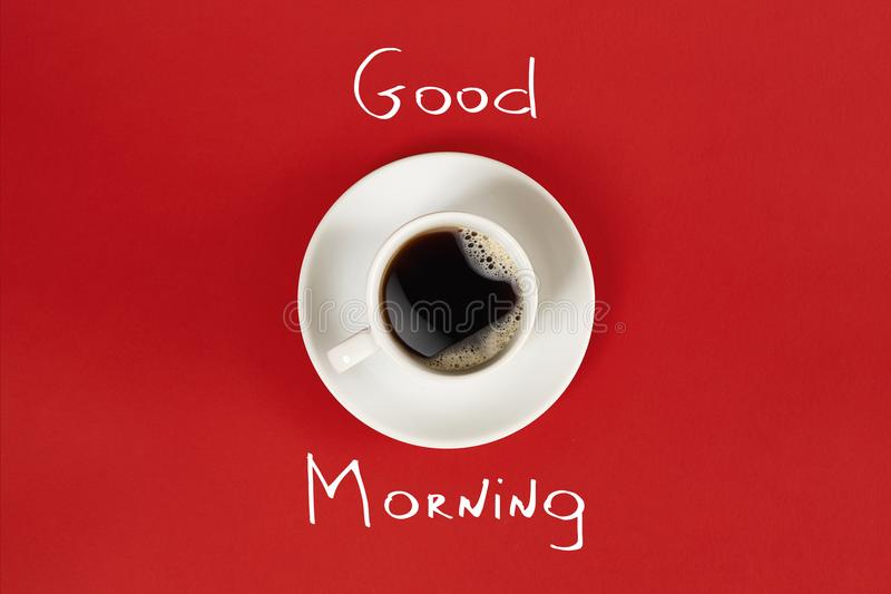 Close-up top view of cup of fresh hot coffee and good morning inscription stock photo