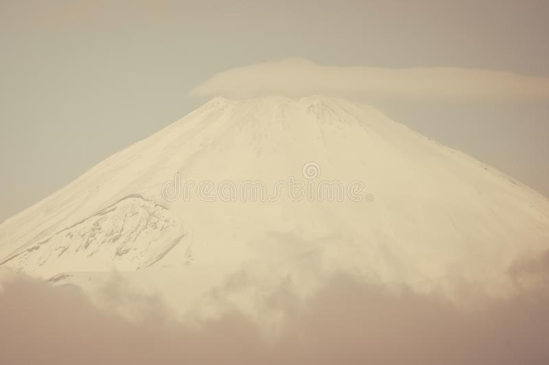 Top view of Fuji mountain with snow cover with could royalty free stock photos