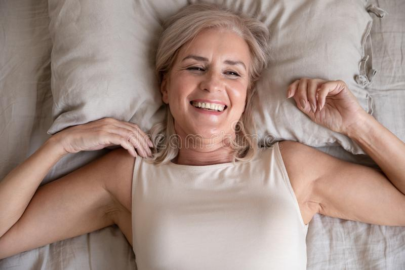 Top view of smiling senior woman wake up feeling positive royalty free stock photos