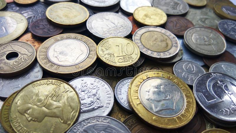 Large amount of old money coins of different countries and times background. Close up top view image of large amount of old money coins of different countries stock photos