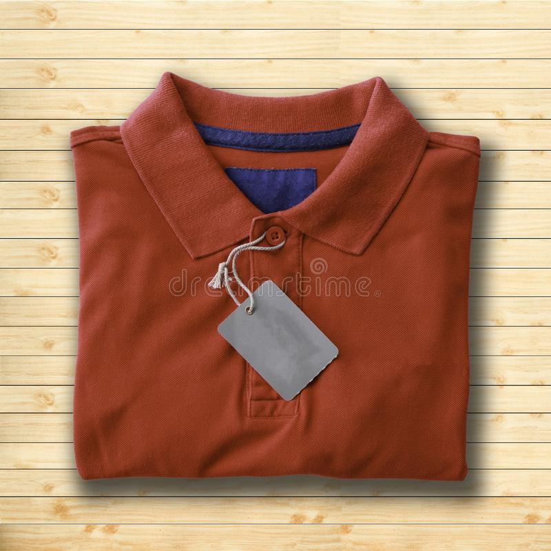 Polo shirt. Close up top view of man polo shirt put on rustic wooden table top with blank space use for texts display stock photography