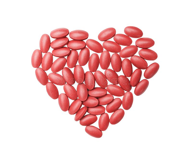 Top view nourishing blood medication tablets and vitamin in heart shaped patterns isolated on white background with clipping path. Close up Top view nourishing stock photos