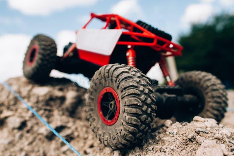Close-up of toy crawler riding through rocks royalty free stock photography