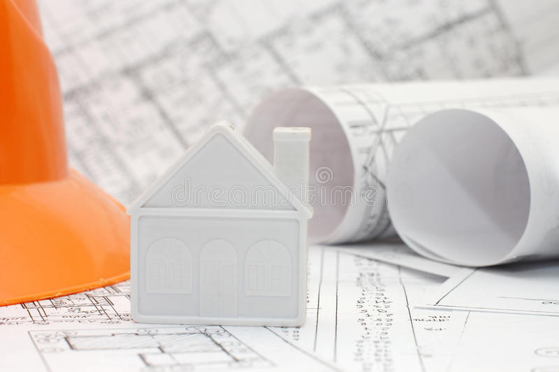 Close-up of toy house model on blueprints stock image