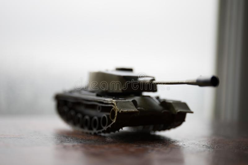 Close up of toy military tank. Selective focus. Battle or war concept. Ual image stock images