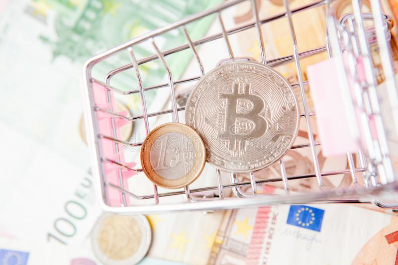 Close up toy shopping cart with bitcoin on a euro background, saving money for future, ethereum cryptocurrency, blockchain. Business technology concept, pink stock photos