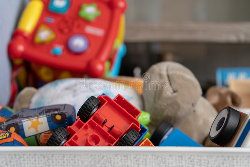 Close up of toys, with many different objects including soft toys, play cars and toddler toys royalty free stock image