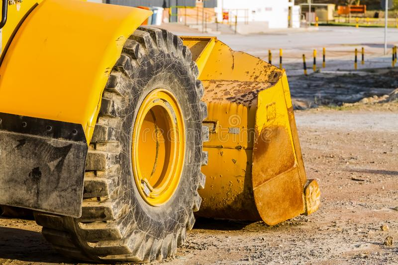 Close up of a tractor tire, Front end loader. Close up of a tractor tire, Yello Front end loader royalty free stock images