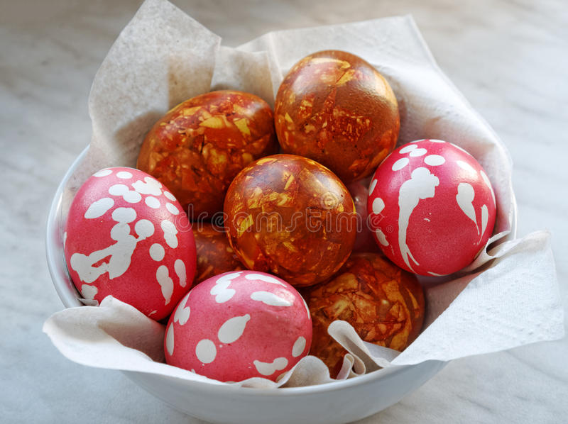 Close-up traditional hand made coloring easter eggs. Made with onion peel. Selective focus royalty free stock image