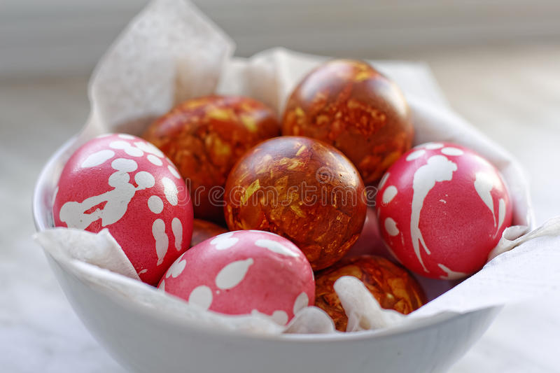 Close-up traditional hand made coloring easter eggs. Made with onion peel. Selective focus stock image