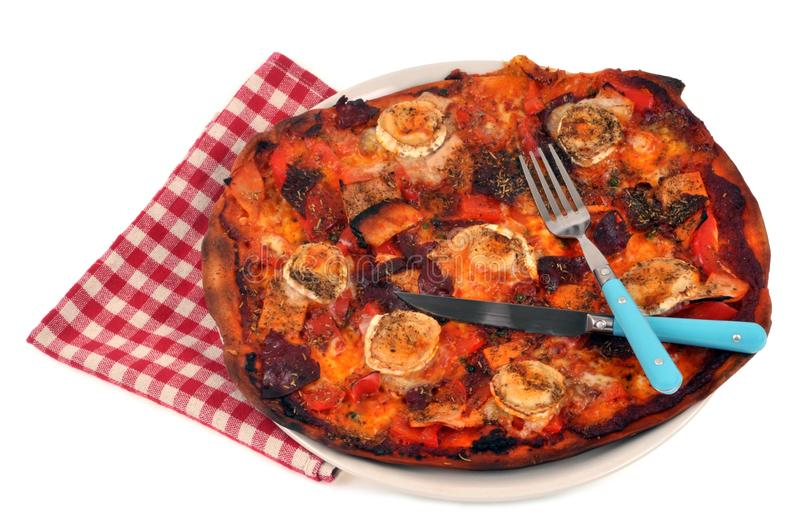 Homemade pizza in a plate on a white background stock photography