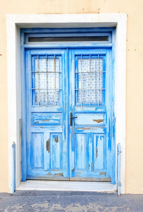 Beautiful pastel blue coloured wooded door, Santorini, Greece. Close up of a Traditional pastel blue coloured wooded door, Santorini, Greece royalty free stock image