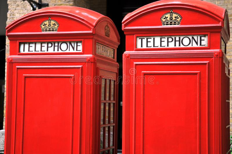 Red phone booths in London. Close-up on traditional telephone booths in England stock images
