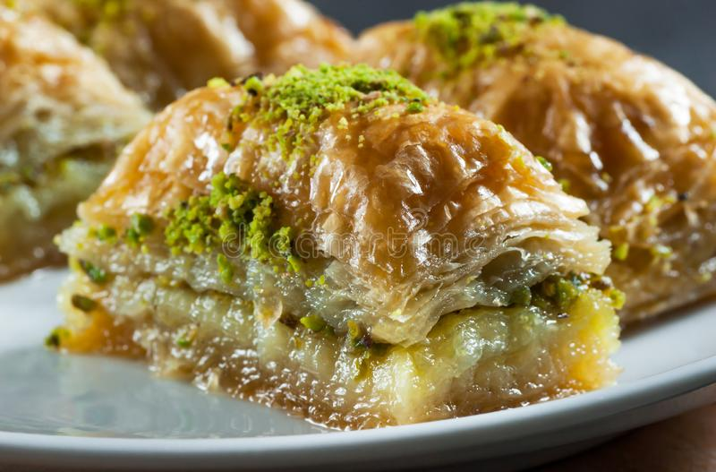 Close up Traditional turkish dessert antep baklava with pistachio on white plate. Traditional turkish dessert antep baklava with pistachio on white plate stock photo