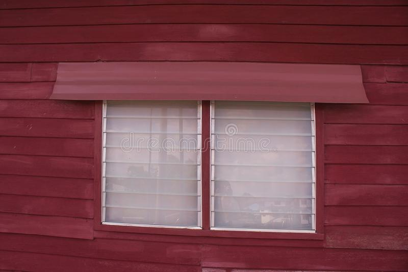 Close up traditional wooden window with glass louver of wooden house in Thai style. royalty free stock image