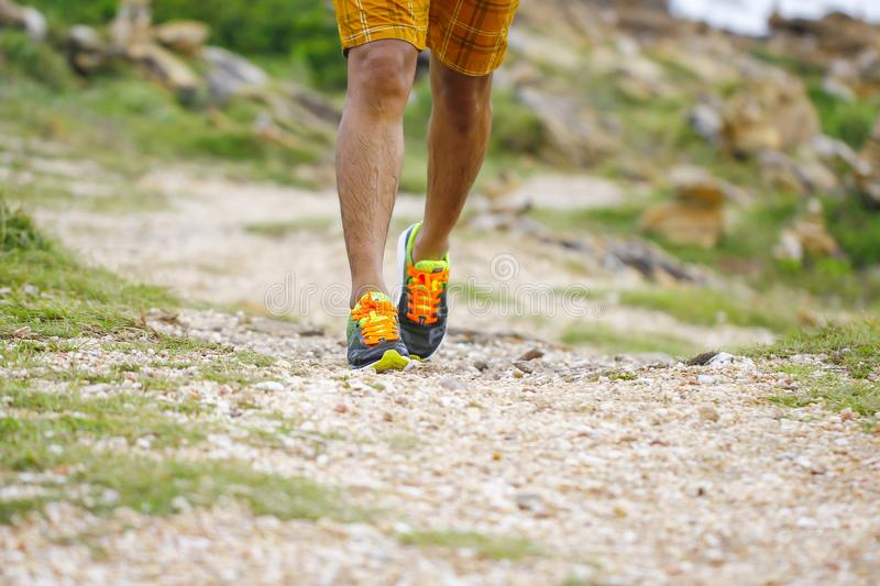 Close up of an athlete`s feet wearing sports shoes on a challeng stock image