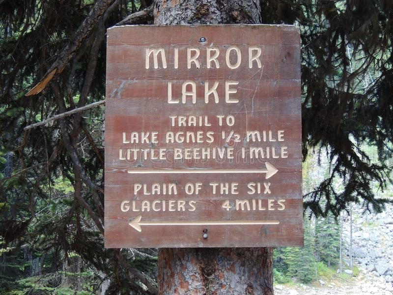 Trail Sign for Mirror Lake, Lake Agnes, Little Beehive, and Plain of Six Glaciers close to Lake louise, in Banff national park, Al. Close up of Trail Sign for stock images