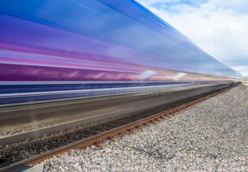Close up of train speeding through English countryside with motion blur royalty free stock photography