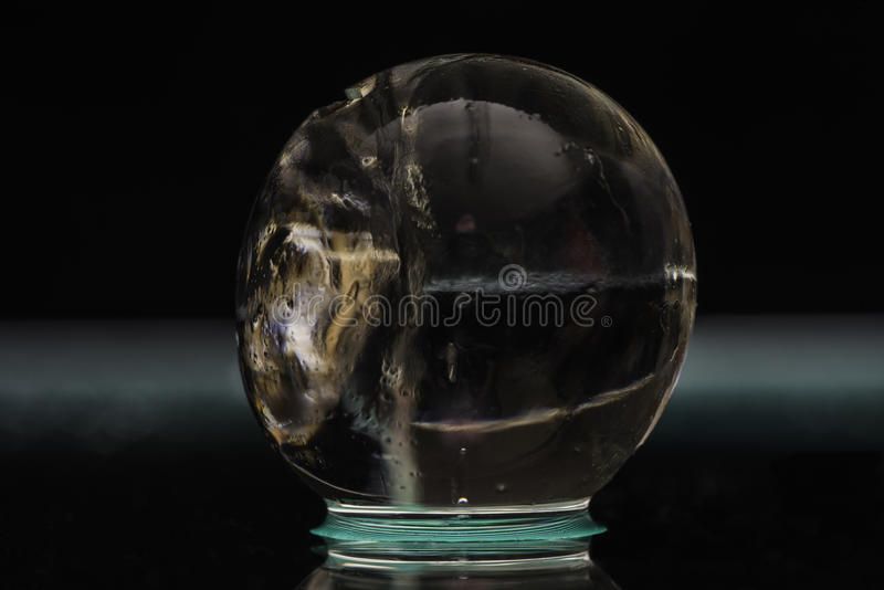Close-up of transparent hydrogel ball with colorful material inside. The color inside the ball is caused by a chemical reaction concluded inside the orb stock photography