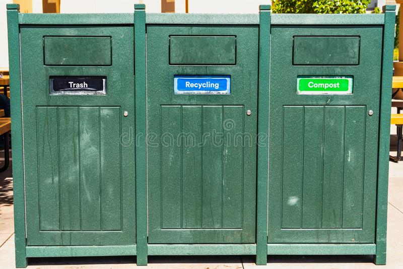 Close up of Trash, Recycling and Compost bins royalty free stock photo