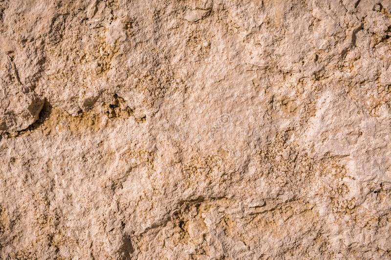 Close up of travertine stone rough surface royalty free stock image