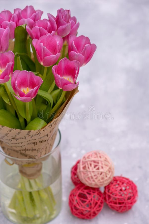 Close-up tulips in vase on gray background royalty free stock photography
