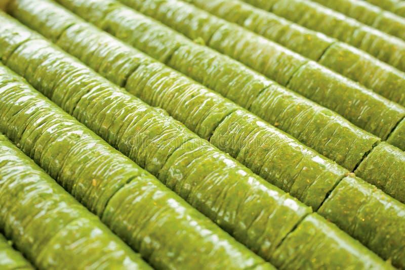 Turkish pistachio wrap baklava dessert fistik sarma fistik ezmesi. Close up for turkish pistachio wrap baklava dessert fistik sarma fistik ezmesi stock photos
