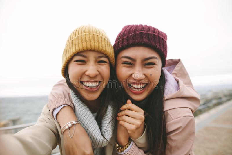 Close up of two asian women standing together outdoors stock images