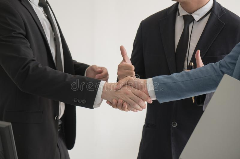 Close-up two business man checking hand to success deal after me stock photo