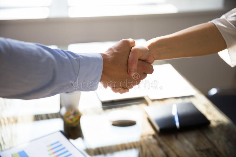 Close-up Of Two Business Partners Shaking Hands royalty free stock image