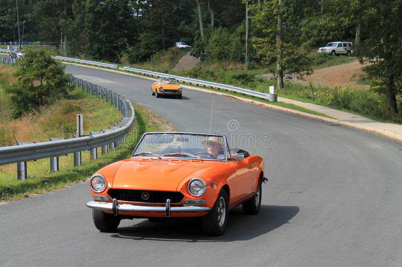 Download Close Up Two Classic Orange Italian Sports Cars On Road Editorial  Photography   Image: