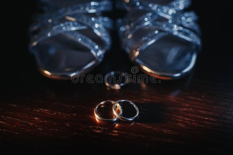 Close-up of two gold wedding rings in a black background.Wedding ring.Wedding rings.  stock image