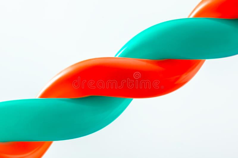 Close-up of two green and red balls. Bound together on white isolated backgroundn royalty free stock images