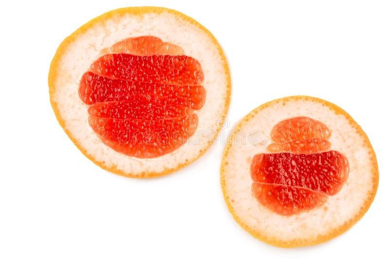 Close-up two halves of a delicious grapefruit isolated over the white background. stock image