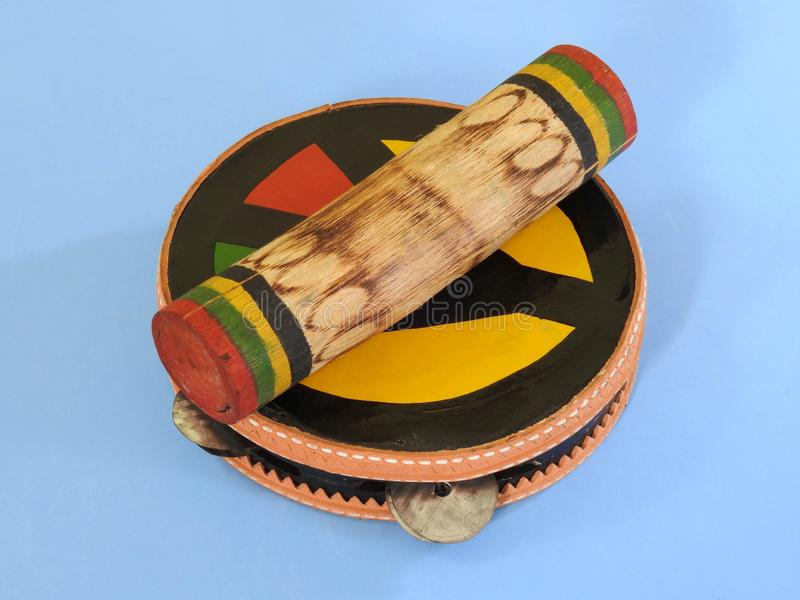 """Close-up of two handmade Brazilian percussion instruments: pandeiro tambourine and """"ganzá"""", a type of rattle. stock images"""
