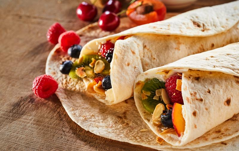 Close up on two healthy fresh fruit and nut wraps stock photography