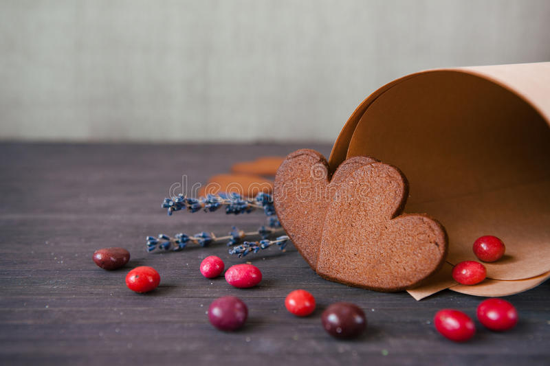 Close up two heart shaped gingerbread with lavender and candy. royalty free stock image
