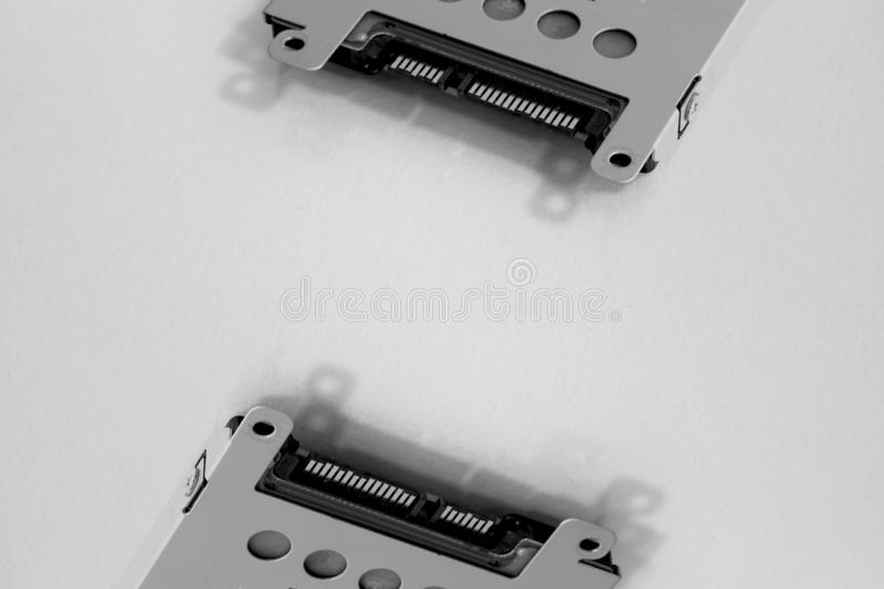 Close up on two laptop hard drives. stock images