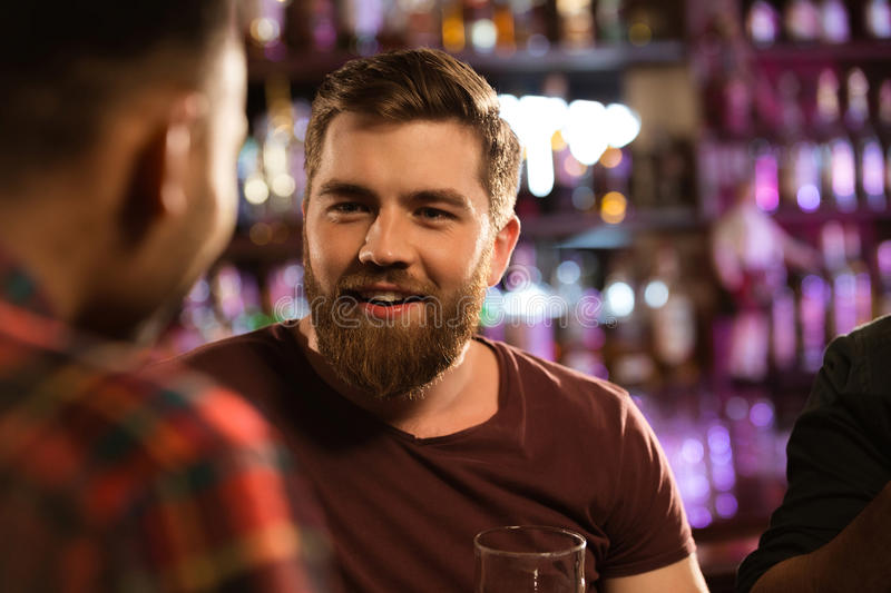 Close up of a two male friends drinking draft beer stock images