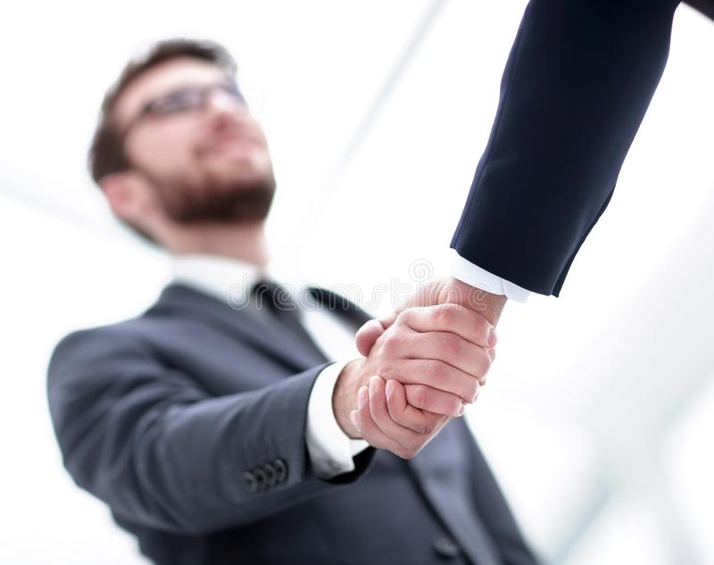 Handshake closeup of businesswoman and businessman. Close-up of two man hands shaking after signing contract stock photo