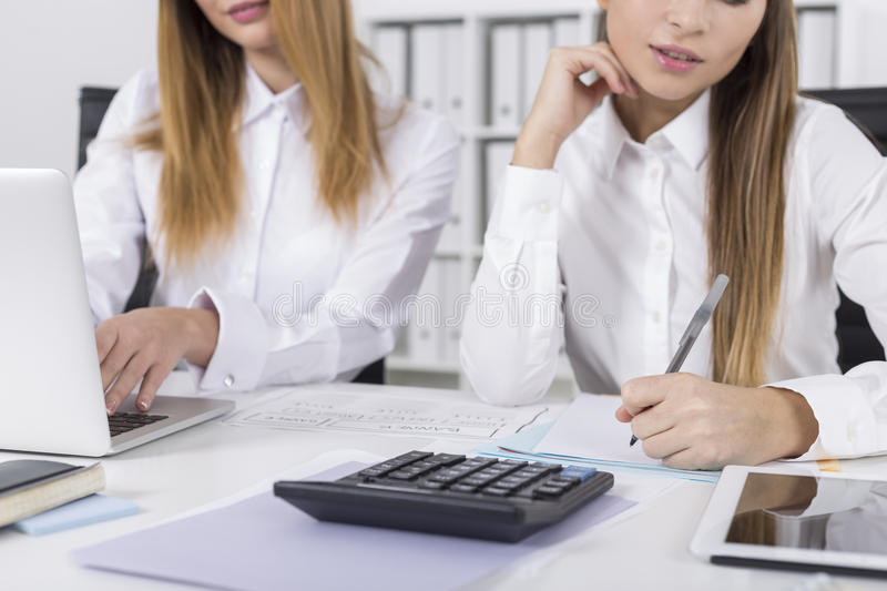 Close up of two office employees doing their work stock images