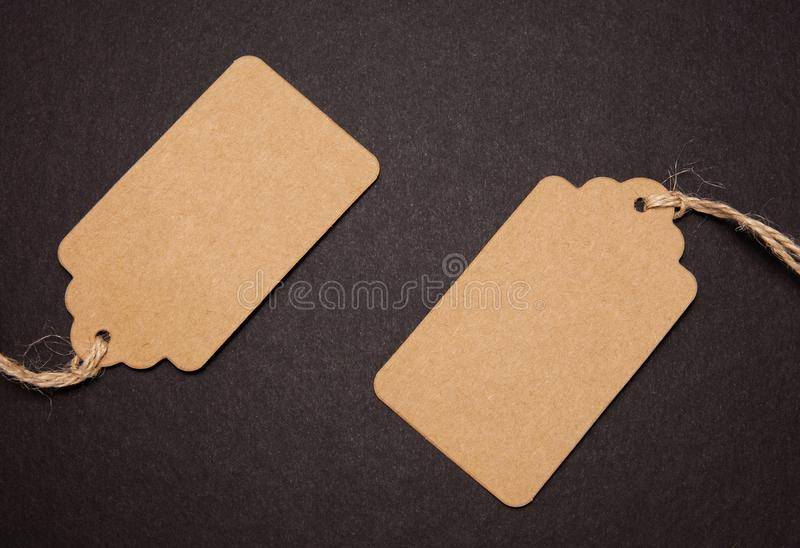 Close-up, two price tags on black background royalty free stock image