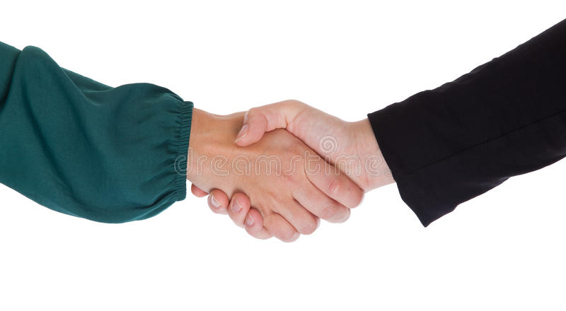 Close up of two women shaking hands stock images