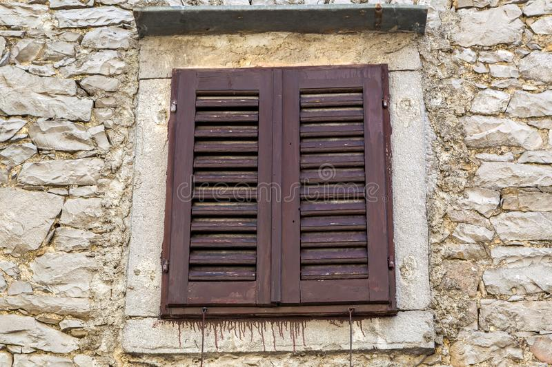 Close up of typical brown window in Istria - Croatia. Shot of old Church in town Draguc - Istria, Croatia stock image