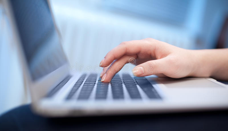Close-up of typing hands royalty free stock photos