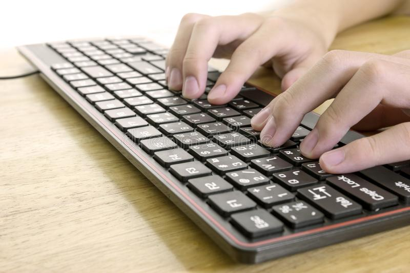 Close up of typing male hands on black keyboard,Businessman working concept,light effect royalty free stock images