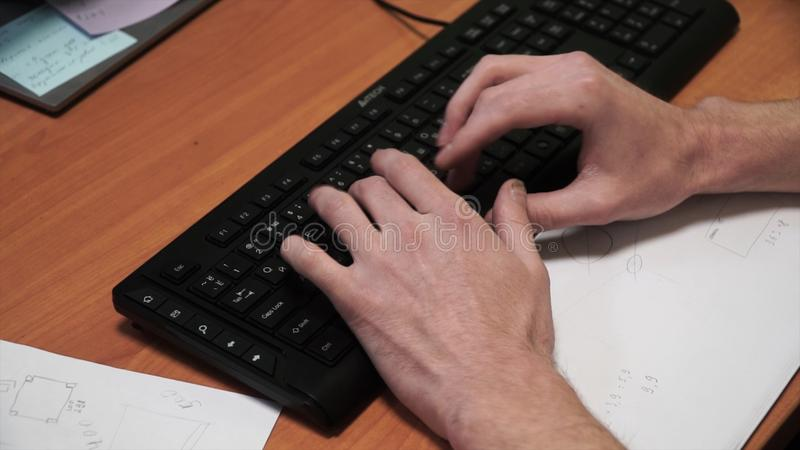 Close-up of typing male hands. Clip. Hands on keyboard. Close-up of male hand before touching button of black computer stock images